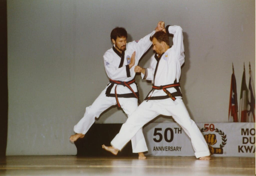 Frank Schermerhorn Sa Bom Nim and Williams Johns Sa Bom Nim demonstrating at the Moo Duk Kwan 50th Anniversary in Korea